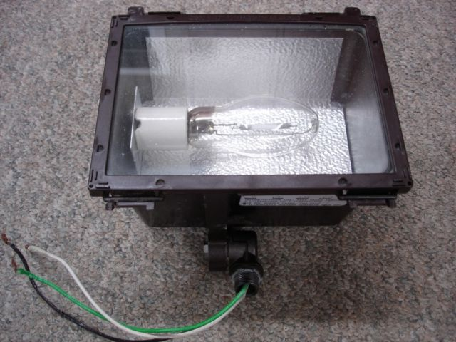 An Acculite 35w High Pressure Sodium Swivel Mount Flood Light Fixture