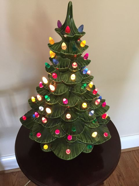heres a ceramic light up christmas tree made by my great grandmother in 1969 one of our most special family heirlooms and christmas decorations